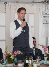 Groomsmen saying his speech