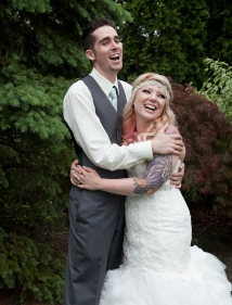 Bride and Groom laughing at something silly